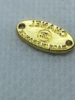 1 tiny oval gold sew on Made in France button, 12 mm
