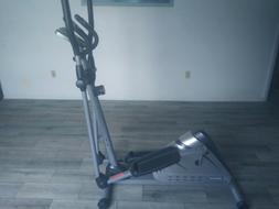 Exerpeutic Pulse elliptical machine on rollers
